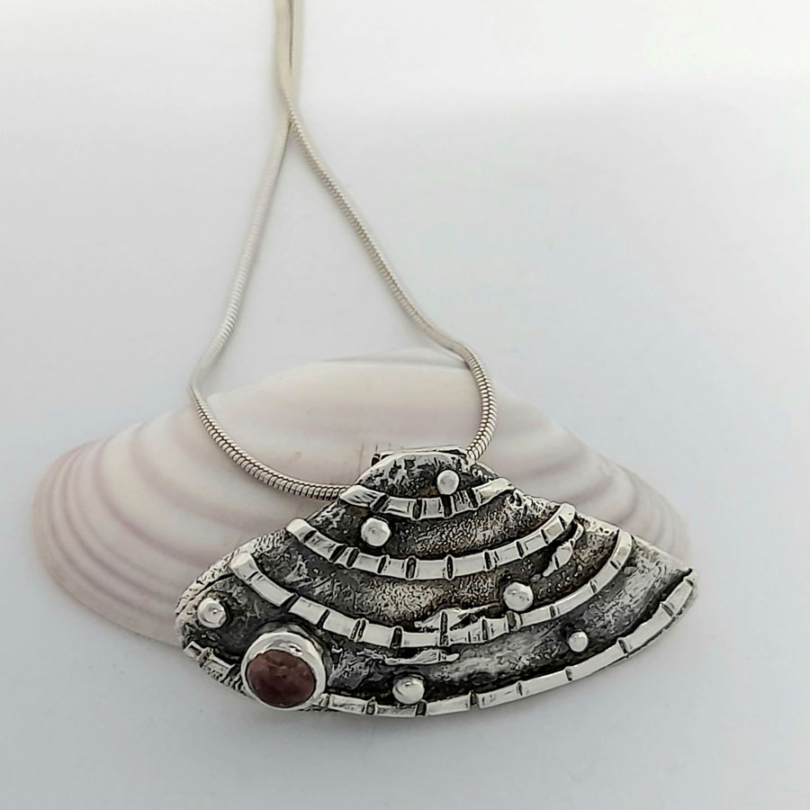 banded wedge silver shell pendant with pink tourmaline