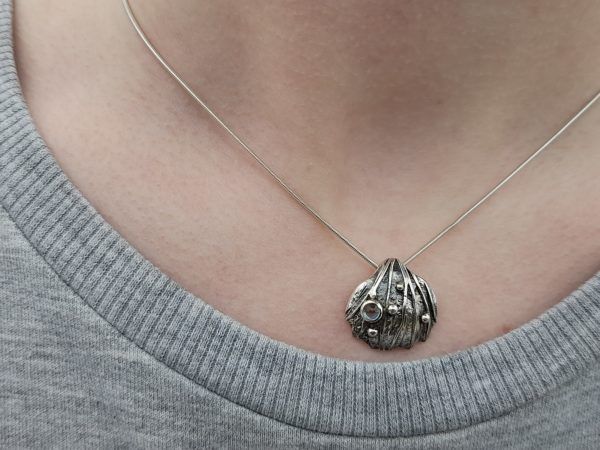 Silver Cockle Shell Pendant with Topaz (shown on model)