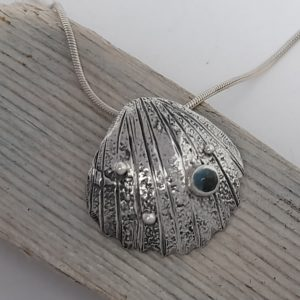 Textured Silver Cockle Shell Pendant with Topaz